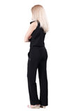 Back view of standing young beautiful  blonde woman. Royalty Free Stock Photography