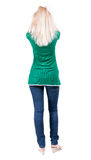 Back view of standing young beautiful  blonde woman. Royalty Free Stock Images