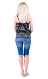 Back view of standing young beautiful  blonde Royalty Free Stock Photo