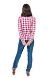 Back view of standing young beautiful  brunette woman in checker Stock Photography