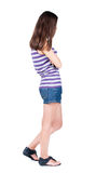 Back view of standing young beautiful  brunette woman. Stock Photo