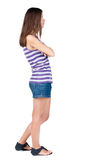 Back view of standing young beautiful  brunette woman Stock Photos