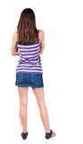 Back view of standing young beautiful  brunette woman Royalty Free Stock Images