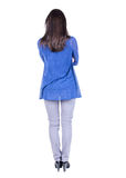 Back view of standing young beautiful  brunette woman. Royalty Free Stock Images