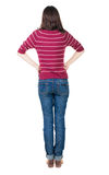 Back view of standing young beautiful  brunette woman in red pul Royalty Free Stock Photo