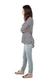 Back view of standing young beautiful  brunette woman in striped Stock Photos
