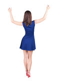 Back view of standing young beautiful  brunette woman thumbs up. Royalty Free Stock Photos
