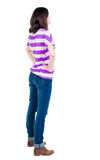 Back view of standing young beautiful  brunette woman in yellow Royalty Free Stock Images