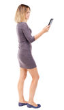 Back view of standing young beautiful  girl with tablet computer Stock Photos