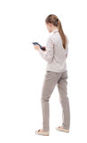 Back view of standing young beautiful  girl with tablet computer Royalty Free Stock Photography