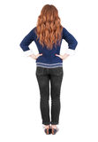 Back view of standing young beautiful  redhead woman. Stock Image