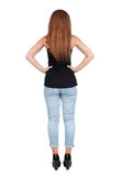Back view of standing young beautiful  redhead woman. Stock Photos