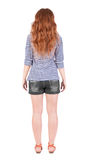 Back view of standing young beautiful  redhead woman Stock Photo