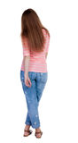 Back view of standing young beautiful  redhead woman. Royalty Free Stock Images