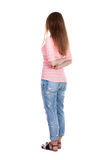 Back view of standing young beautiful  redhead woman. Royalty Free Stock Photography