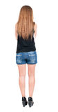 Back view of standing young beautiful  redhead woman. Royalty Free Stock Photo