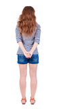 Back view of standing young beautiful  redhead woman Royalty Free Stock Photos