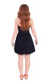 Back view of standing young beautiful  redhead woman Stock Image