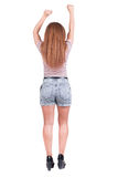 Back view of standing young beautiful redhead woman thumbs up. Stock Image