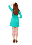 Back view of standing young beautiful  woman. The girl in a blue Royalty Free Stock Photos