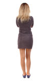 Back view of standing young beautiful  woman. Stock Image