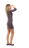 Back view of standing young beautiful  woman. Stock Images