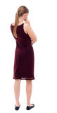 Back view of standing young beautiful  woman. Royalty Free Stock Images