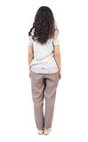 Back view of standing young beautiful  woman. Royalty Free Stock Photos