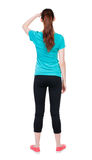 Back view of standing young beautiful  woman. girl  watching. Royalty Free Stock Images