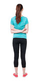 Back view of standing young beautiful  woman. girl  watching. Royalty Free Stock Image