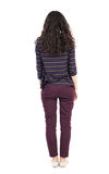 Back view of standing young beautiful  woman.  girl  watching. Stock Photography