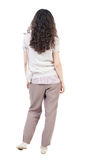 Back view of standing young beautiful  woman.  girl  watching. Stock Photos