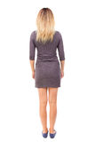 Back view of standing young beautiful  woman. Stock Photos