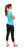 Back view of standing young beautiful  woman. girl  watching. Rear view people collection.  backside view of person.  Isolated over white background. Sport Stock Images
