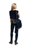 Back view of standing young beautiful woman. royalty free stock image