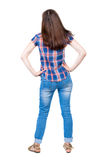 Back view of standing young beautiful  woman.  girl  watching. Rear view people collection.  backside view of person. Royalty Free Stock Photography