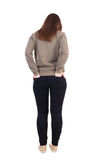 Back view of standing young beautiful  woman in jeans. Royalty Free Stock Photo