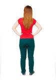 Back view of standing young beautiful  woman in jeans. Royalty Free Stock Images