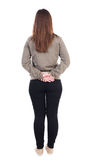 Back view of standing young beautiful  woman in jeans. Stock Image