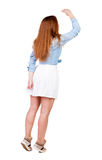 Back view of standing young beautiful  woman. Royalty Free Stock Photography