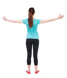 Back view of standing young beautiful  woman in in sportswear  i Stock Photos