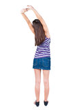 Back view of standing young beautiful  woman thumbs up. Royalty Free Stock Photos