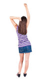 Back view of standing young beautiful  woman thumbs up. Royalty Free Stock Photo