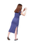 Back view of standing young beautiful  woman  and using a mobile Stock Photography