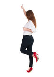 Back view of standing young redhead business woman showing thumb. Up. beautiful businesswoman in black suit gesturing ok sign. Rear view people collection Royalty Free Stock Image