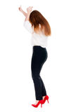 Back view of standing young redhead business woman showing thumb. Up. beautiful businesswoman in black suit gesturing ok sign. Rear view people collection Royalty Free Stock Photos