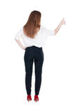 Back view of standing young redhead business woman showing thumb Stock Image