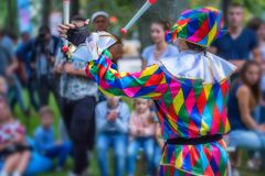Back view streert juggler in bright clothing Stock Image