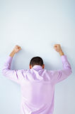 Back view of stressed business man with hands up Royalty Free Stock Photo