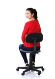 Back view student woman siting on armchair Royalty Free Stock Image
